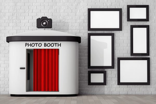 Photo Booth in front of Brick Wall with Blank Picture Frames extreme closeup. 3d Rendering